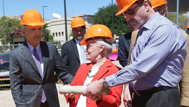 University of Texas at El Paso President Diana Natalicio holds a core sample with former El Paso Mayor Oscar Leeser during a ceremony to announce the building of a new Interdisciplinary Research Building at the corner of University Avenue and Sun Bowl Drive on the UTEP campus. At left is U.S District Judge Philip Martinez. The sample was taken on the site where the 162,000-square-foot, $85 million facility is being built.
