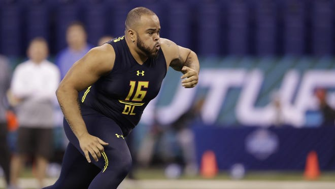Texas A&M offensive lineman Jermaine Eluemunor runs a drill at the NFL scouting combine.