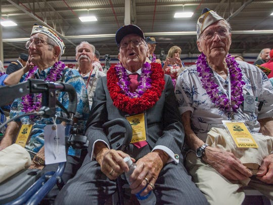 Milton Mapou (left) of the USS Detroit, Donald Stratton (center) of the USS Arizona, and Thomas Berg (right) of the USS Tennessee wait for the start of the opening ceremony for the 75th anniversary of the Japanese attack on Pearl Harbor on Wednesday, Dec. 7, 2016, in Honolulu.