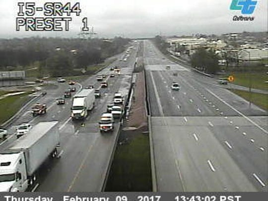 A California Department of Transportation traffic camera shows a traffic slowdown near a wreck on Interstate 5 near Highway 44.
