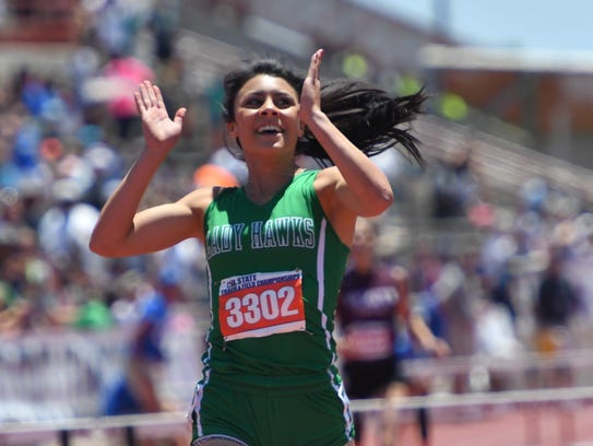 Wall's Faith Roberson celebrates after winning the