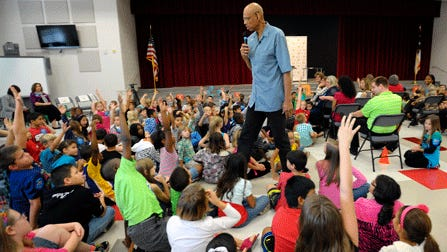 Former NBA basketball player Kareem Abdul Jabbar talks to students from Irwin Intermediate School during Reading Is Fundamental's literacy celebration last fall in Ft. Bragg, N.C. A number of states have focused on improving reading by the third grade.