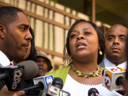 Shanesha Taylor addresses the media following her settlement with the Maricopa County Attorney's Office on Friday, July 18, 2014. Taylor must complete a diversion program to have the child-abuse charges dropped. She was charged in March for leaving her children in the car in Scottsdale applying for a job.
