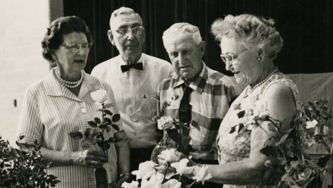Award winners at an Eastern Indiana rose show in the early 1970s are (from left) Mrs. and Mr. Harvey Davidson, Rowland Webb and Mrs. Wescott.