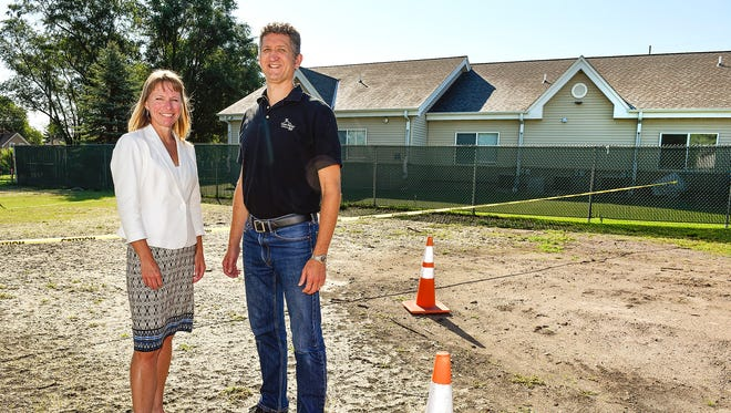 Melinda Sanders, campaign chair of the capital campaign for Anna Marie's Alliance, and Charles Hempeck, executive director of Anna Marie's, show the lot next to the shelter Friday, Aug. 11, for expansion