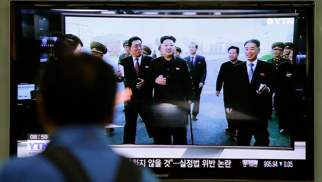 A man watches a TV news program showing North Korean leader Kim Jong Un using a cane during his first public appearance, at the Seoul Railway Station in Seoul, South Korea, Tuesday, Oct. 14, 2014. North Korean Leader Kim Jong Un has made his first public appearance in five weeks, state media reported Tuesday, ending an absence that drove a frenzy of global speculation that something was amiss with the country's most powerful person.