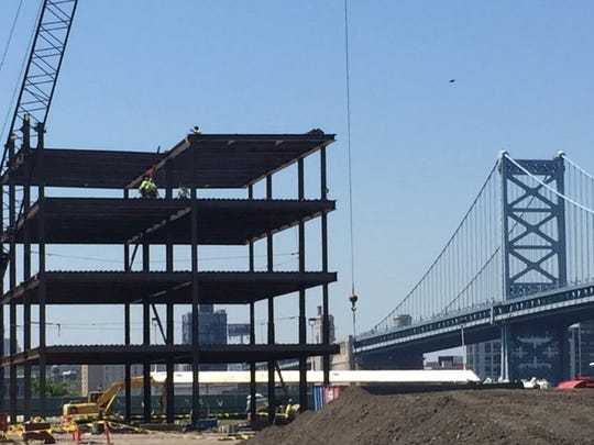 Workers are building a new headquarters for American Water Works on Camden's Waterfront.
