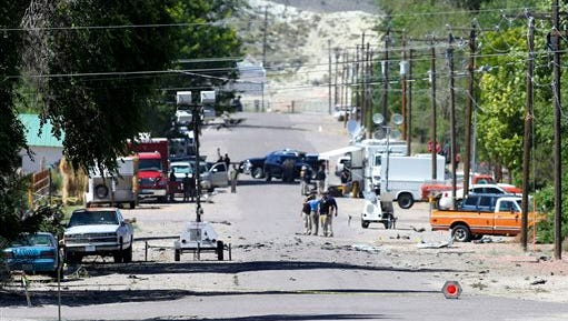Police Thursday investigate shrapnel from a bombing that killed one person on 5th Street in Panaca, Nev., on Wednesday.