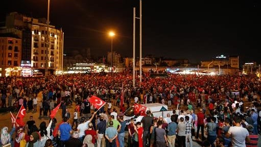 People gather at a pro-government rally in central Istanbul's Taksim square, Saturday, July 16, 2016. Forces loyal to Turkish President Recep Tayyip Erdogan quashed a coup attempt in a night of explosions, air battles and gunfire that left some hundreds of people dead and scores of others wounded Saturday.