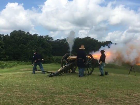 Civil War reenactors fire a cannon at the Vicksburg