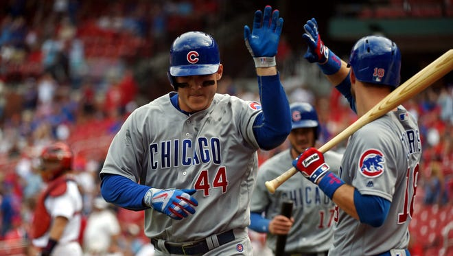 Anthony Rizzo is congratulated by Ben Zobrist after hitting a two run home run.