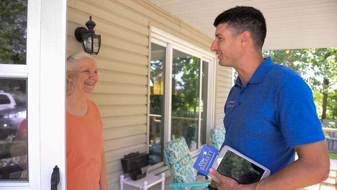 Incumbent state Rep. Tom Barrett, R-Potterville, chats with Carol Westen at her home in Grand Ledge on Tuesday, Sept. 6, 2016.