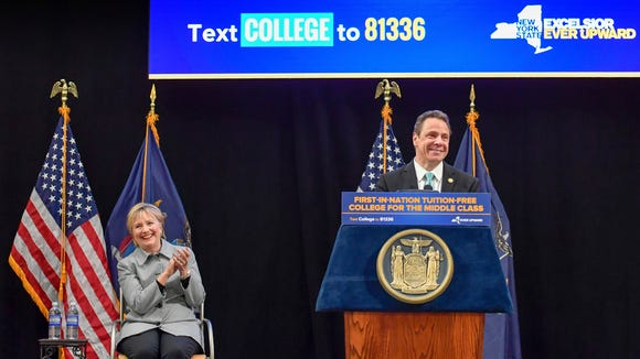 In this April 12, 2017 file photo provided by the Office of Governor Andrew M. Cuomo, Hillary Clinton applauds as Gov. Cuomo speaks from the podium at LaGuardia Community College in the Queens borough of New York during a ceremonial bill signing of the a first-in-the nation free tuition plan for students from middle-class families. Speculation Cuomo is plotting a run for president grew louder this week after his appearance with Hillary Clinton and budget plan some observers say reads like a map to the White House.