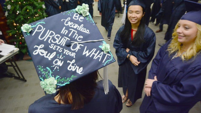 """In this file photo, Ashly Decker's graduation is punctuated with a motto: """"Be fearless in the pursuit of what sets your soul on fire."""" The Grow PA initiative aims to stem the brain drain that occurs when college graduates leave Pennsylvania in pursuit of better opportunities. Bil Bowden photo."""