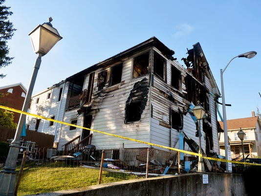 The back side of 20 S. Charles St. can be seen Wednesday, Sept. 16, 2015, the morning after an early-morning fire consumed one home and damaged another in Red Lion. Five people were displaced from 20 S. Charles St., while at least two others were displaced from 35 S. Charles St. next door. Chris Dunn Ñ Daily Record/Sunday News
