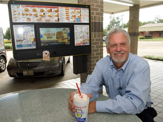 Buddy McClain enjoys a milkshake at the Sonic restaurant