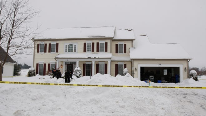Deputies were looking through the snow for evidence on Tuesday morning, Feb. 10, 2015.