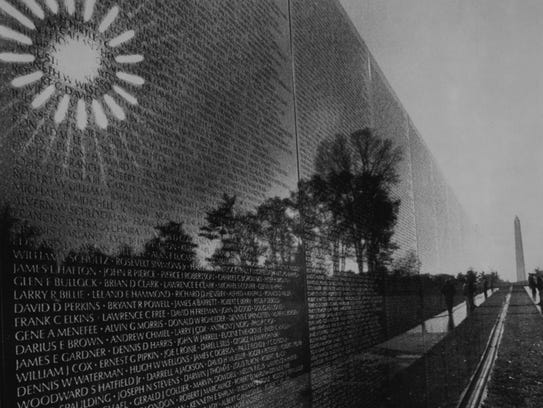 The sun reflects on the Vietnam Veterans Memorial in