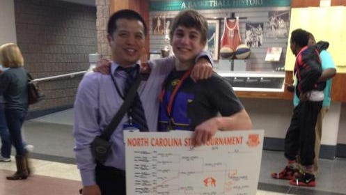 North Henderson junior Mitchel Langford, right, and Knights wrestling coach Heang Uy.