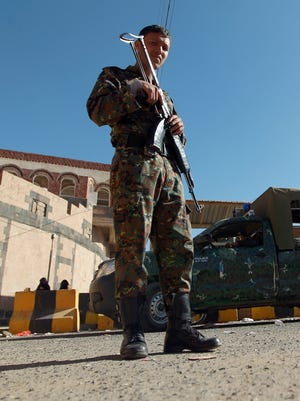 A Yemeni soldier stands guard outside the United States' embassy on February 11, 2015 in the capital Sanaa, a day after its closure.