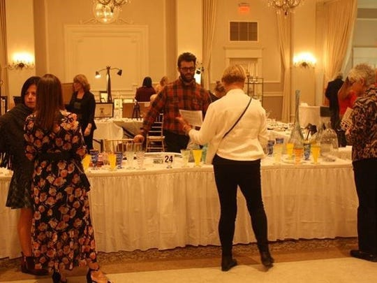 Guests peruse the works of art at the Inspira Auxiliary