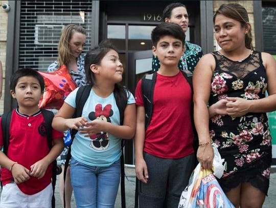 Yeni Gonzalez, right, stands with her children Lester,