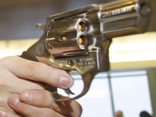 A_WOMAN SHOOTING A G.jpg