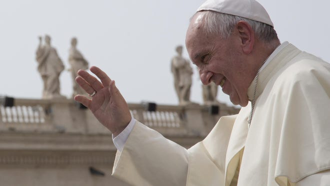 Pope Francis waves after his weekly general audience at the Vatican. Pope Francis waves after his weekly general audience in St. Peter's Square at the Vatican, Wednesday, Sept. 9, 2015. (AP Photo/Alessandra Tarantino)