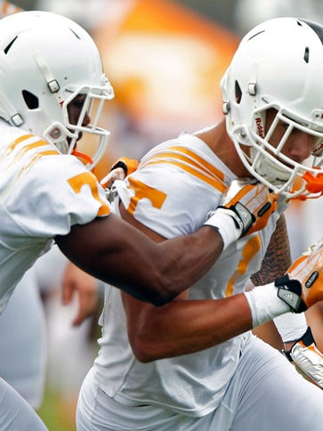 Tennessee running back Jalen Hurd (1) works against Drae Bowles (7) during practice at Haslam Field, Saturday, Aug. 2, 2014 in Knoxville, Tenn.  (AP Photo/The Knoxville News Sentinel, Wade Payne)