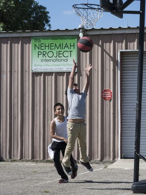 Cristian Jiminez, 10, left, and his brother Julian Jiminez, 9, play basketball on Thursday, April 20, 2017. The Nehemiah Project serves at risk kids through a Christ based after school program and distributes food and clothing.