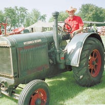 Jim Zahn, a member of the Dodge County Antique Power Club in 2002, sits on his father's antique McCormick-Deering tractor at the 34th Annual Antique Power Show.