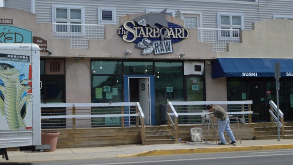 A construction worker builds the railing for the Starboard