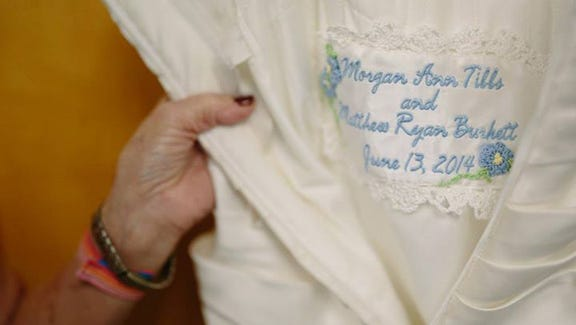 A patch was made from Kammi's original dress and sewn into daughter Morgan's dress.