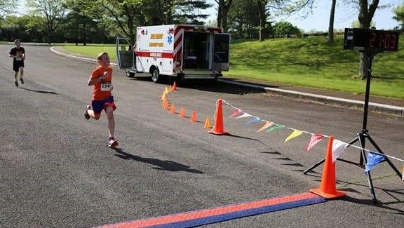 Aaron Wysocki (Asbury) taking first place at the Freedom House 5K Run & Walk.