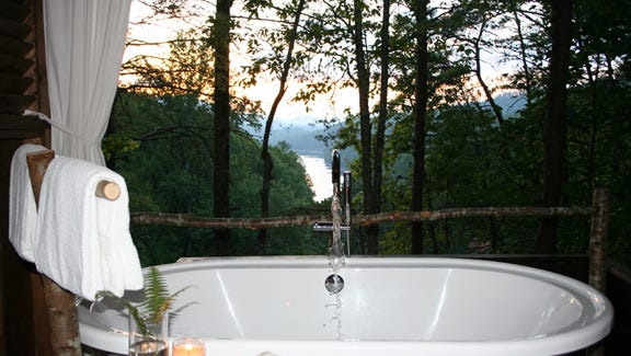 A beautiful sunset view from the Tree Top Soaking Cabana also overlooks Fontana Lake and the Smoky Mountains.