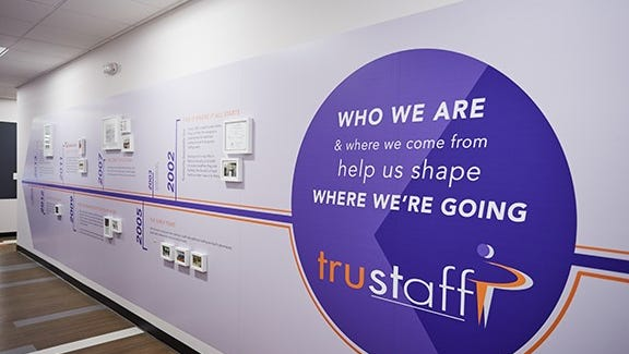 Trustaff chronicles its 15-year history of growth in a wall display at its Blue Ash office.