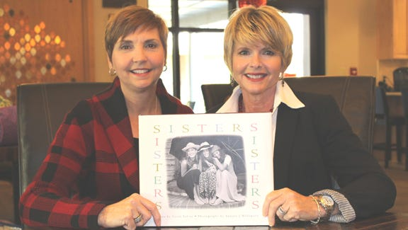 Donna Foster and her sister, Rhonda Barnes. The treasured book from her sister Rhonda includes essays and photographs of sisters portraying their unique bonds.