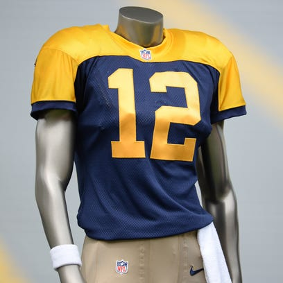 Green Bay Packers president Mark Murphy unveils the new third uniform during the annual shareholders meeting at Lambeau Field July 28, 2015.