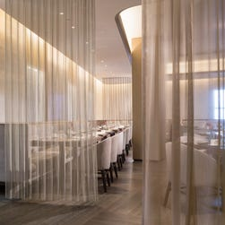 The new Knickerbocker Hotel in New York City  caters to the power breakfast crowd. Its restaurant, Charlie Palmer at the Knick, is designed with chain mail partitions to provide privacy for meetings.