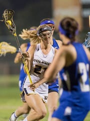 Avery Curington (21) moves through defenders during the district lacrosse semifinals game between Booker T. Washington and Gulf Breeze high schools in Gulf Breeze on Tuesday, April 4, 2017.