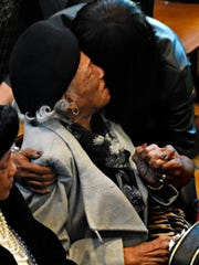 Lorrayne Grimes is comforted as many attend the Celebration