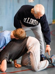 Wrestling head coach Robert Ervin makes a point as
