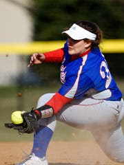 Spring Grove first baseman Hannah Shaffer catches the ball for an out during a game in 2018. Shaffer prefers not to wear a mask because it's uncomfortable and impairs her vision.