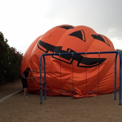 Watch gigantic inflatable pumpkin roll down street