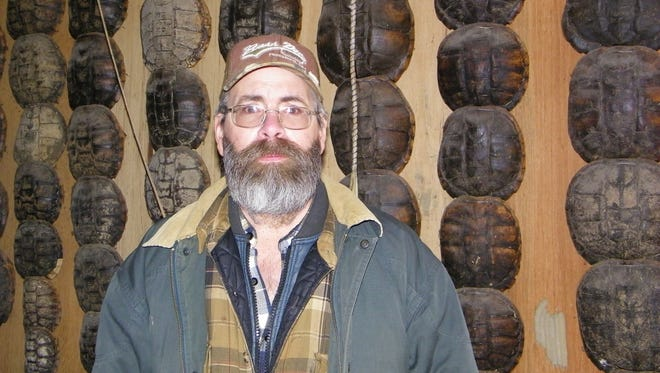 Bob Fisher's garage is lined floor to ceiling with the shells of turtles he has caught through the years.