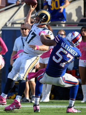 Buffalo Bills outside linebacker Lorenzo Alexander (57) brings down Los Angeles Rams quarterback Case Keenum (17) earlier this year. He is tied for the NFL lead with 10 sacks.