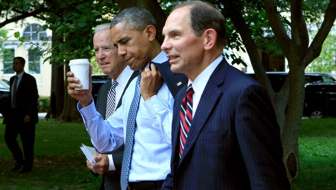 President Barack Obama is flanked by Vice President Joe Biden and former Procter & Gamble exec Robert McDonald (right), Obama's nominee to get the scandal-plagued VA back on track.