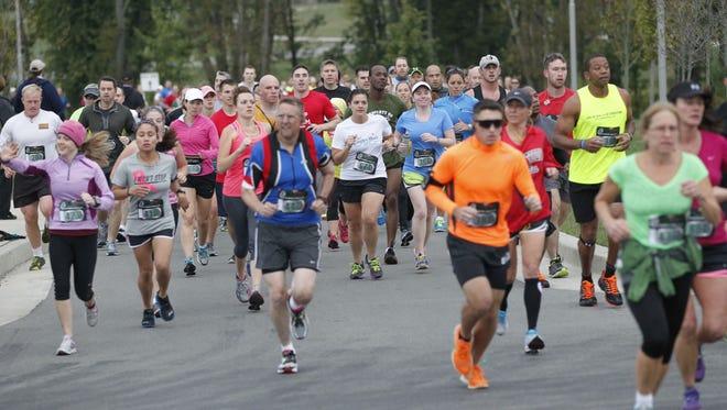 Runners start the Go Commando Half-Marathon in 2013 at Liberty Park.