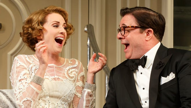 Megan Mullally and Nathan Lane laugh it up.