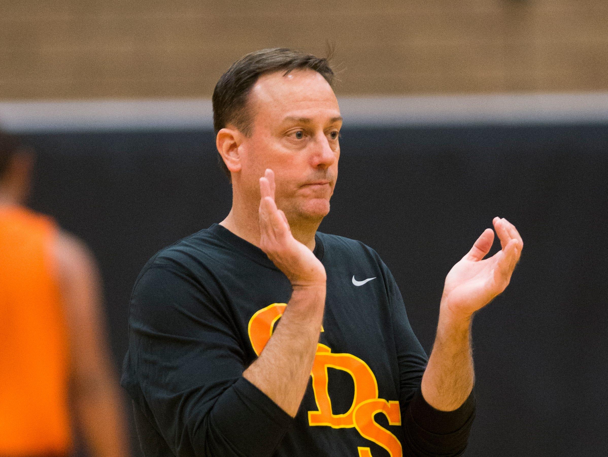 Corona del Sol basketball coach Sam Duane Jr. claps while his team practice in Tempe November 17, 2014.